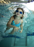 Happy little girl underwater in pool Stock Image
