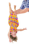 Happy little girl upside down Stock Image