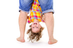 Happy little girl upside down Stock Photo