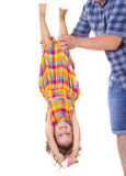 Happy little girl upside down Royalty Free Stock Photography