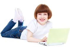 Happy little girl using laptop Stock Photos