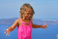 Happy little girl with the view of the Caldera stock images