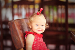 Happy little girl waiting in cafe Royalty Free Stock Images