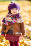 Happy little girl walking in the autumn park Royalty Free Stock Images