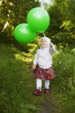 Happy little girl walking Royalty Free Stock Image