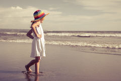 Happy little girl walking at the beach Royalty Free Stock Image