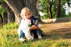 Happy little girl is walking with his dog Royalty Free Stock Photos
