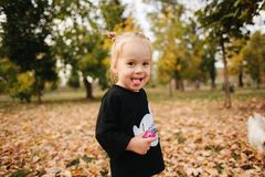 Free Happy Little Girl Walking In The Park In Autumn. Beautiful Female Kid On Yellow Background Royalty Free Stock Images - 159855009
