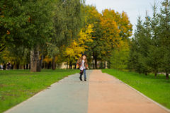 Happy little girl walking in the park. Stock Image