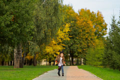 Happy little girl walking in the park. Royalty Free Stock Photo