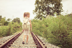 Happy little girl walking on the railway Stock Image