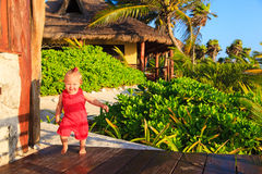 Happy little girl walking in tropical resort Royalty Free Stock Images