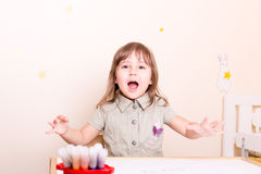 Happy little girl want paint with felt pen stock image