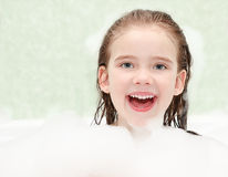 Happy little girl washing in bath Royalty Free Stock Images