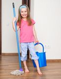 Little girl washing the floor Royalty Free Stock Photos