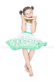 Happy little girl with watermelon. Beautiful little girl eating watermelon and sitting over white background Royalty Free Stock Photos