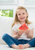 Happy little girl with watermelon Stock Image