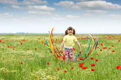 Happy little girl waving with colorful ribbons Royalty Free Stock Image