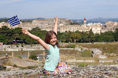 Happy little girl waving with Greek flag Corfu town Royalty Free Stock Images