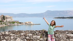 Happy little girl waving with Greek flag in Corfu town stock footage