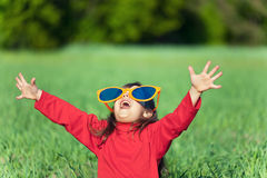 Happy little girl wearing big sunglasses Royalty Free Stock Photography