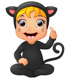 Happy little girl wearing cat costume giving thumb up Royalty Free Stock Images