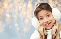 Happy little girl wearing earmuffs Stock Images