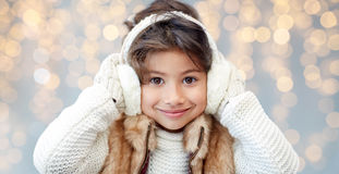 Happy little girl wearing earmuffs Royalty Free Stock Images