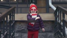 Happy little girl wearing funny swim glasses walking down stairs. Having fun. stock video