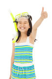 Happy  little girl wearing swimsuit with thumb up Stock Photos