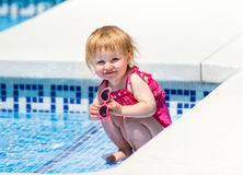 Happy little girl in a wetsuit Stock Photos