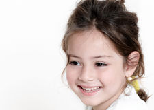 Happy little girl a on white background Royalty Free Stock Images
