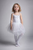 Happy little girl in a ballet dress Royalty Free Stock Image
