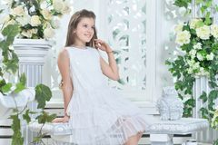 Portrait of a beautiful happy little girl in white dress stock images