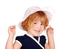 Happy little girl with white hat Royalty Free Stock Photography