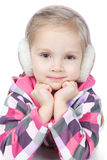 Happy little girl in winter headphones on white Royalty Free Stock Image
