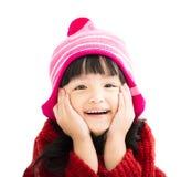 Happy little girl in winter wear. Happy asian little girl in winter wear Royalty Free Stock Photo