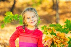 Free Happy Little Girl With Autumn Leaves Stock Images - 127555284