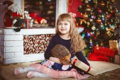 Happy Little Girl With Christmas Gift Box Royalty Free Stock Images
