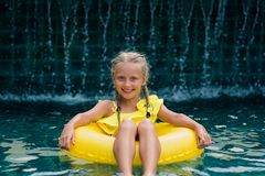 Free Happy Little Girl With Inflatable Rubber Circle Having Fun In Swimming Pool Royalty Free Stock Images - 156955959