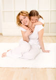 Happy little girl and woman playing together Royalty Free Stock Photo