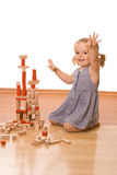 Happy little girl with wooden blocks Royalty Free Stock Images