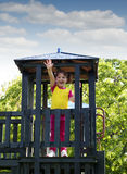 Little girl on wooden tower playground Royalty Free Stock Images