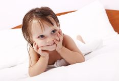 Happy little girl wrapped in towel after bath Royalty Free Stock Image