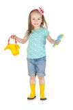 Happy little girl in the yellow boots Royalty Free Stock Photo