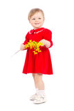 Happy little girl with yellow flower. Isolated over white background Stock Photos