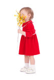 Happy little girl with yellow flower. Isolated over white background Royalty Free Stock Photography