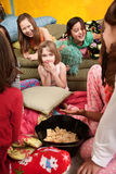 Happy Little Girls. Little girls giggle and eat snacks at a sleepover Stock Photography