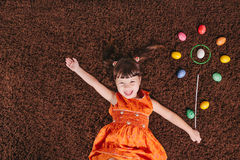 Happy little girls with abstract flower. easter aggs. top view. Royalty Free Stock Photography