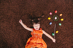 Happy little girls with abstract flower. easter aggs. top view. Stock Image
